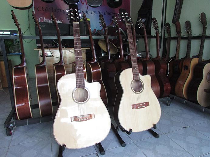đàn guitar acoustic giá rẻ TP. HCM