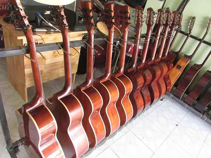 Cam kết giá bán rẻ hơn thị trường-guitar acoustic mambo