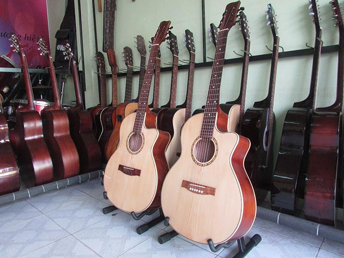 Đàn Guitar Acoustic Gỗ Hồng Đào-Ti Chỉnh Cần